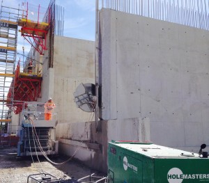 Cutting out a wall section, lifting and removing